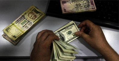 Rupee touches record low of 61 against the US dollar